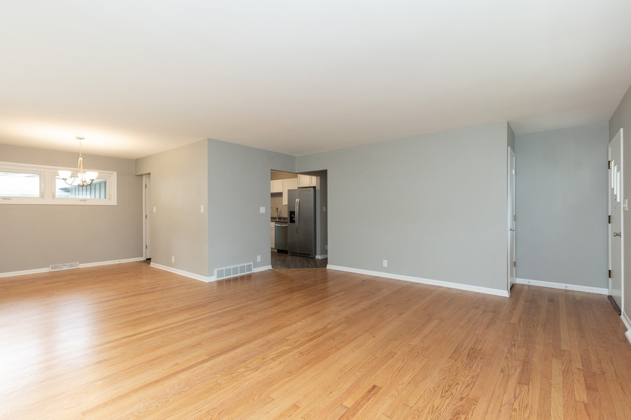 Real Estate Photography - 309 Knollwood Dr, Dekalb, IL, 60115 - Living Room/Dining Room