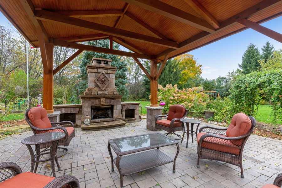 Real Estate Photography - 8N431 Sunny Hill Cir, Campton Hills, IL, 60124 - Fireplace and Patio Structure