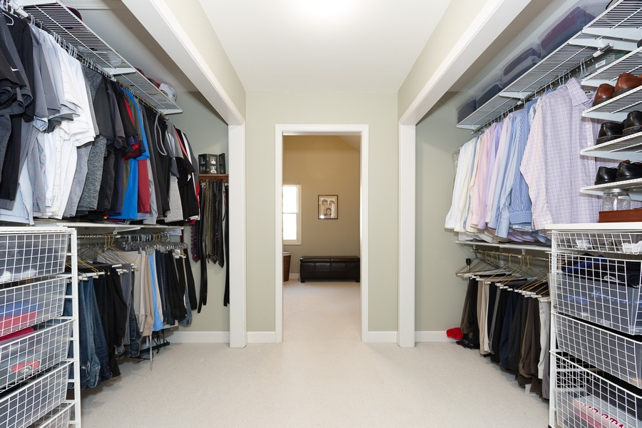 Real Estate Photography - 1015 Revere Ct, Naperville, IL, 60540 - Master Bedroom Walk-In Closet