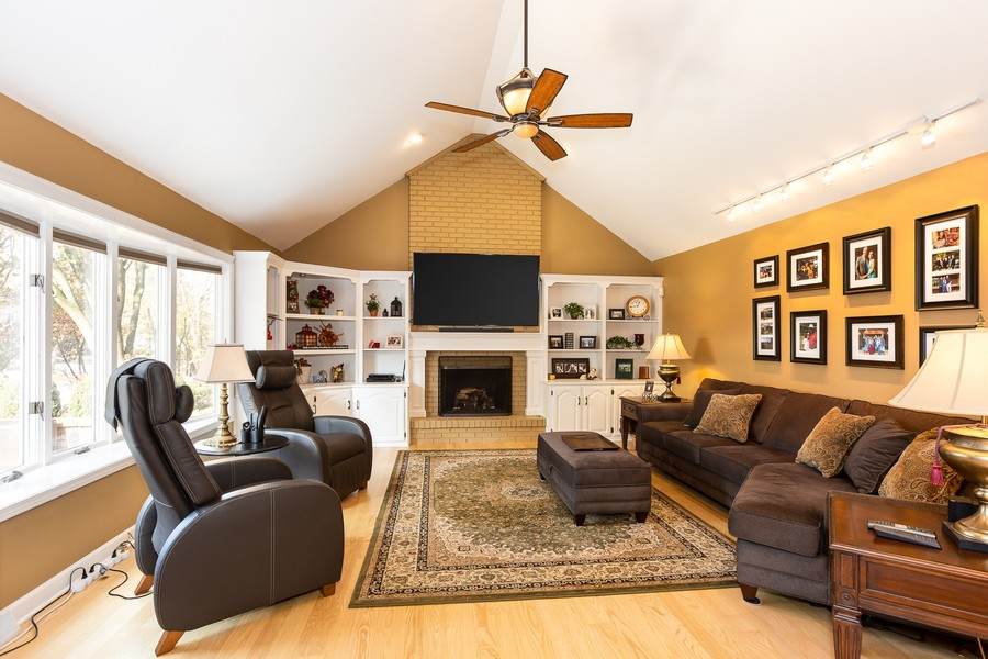 Real Estate Photography - 1015 Revere Ct, Naperville, IL, 60540 - Family Room - Custom Built-Ins, Bay Window, Brick