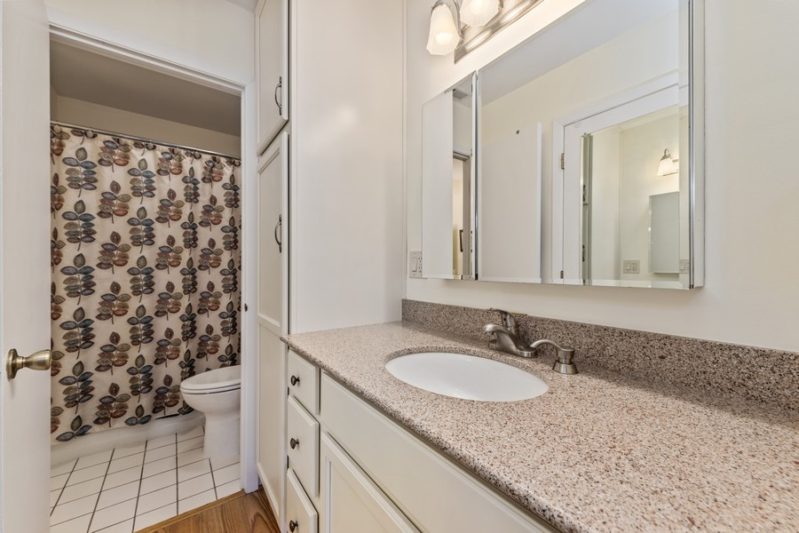 Real Estate Photography - 1731 Harrow Ct, D, Wheaton, IL, 60189 - Private Entry from Master Bedroom into Shared Bath