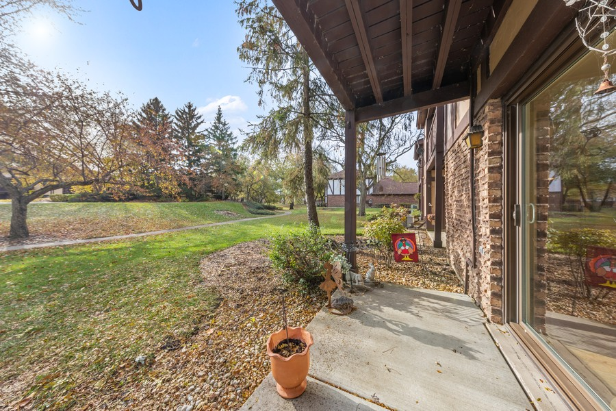 Real Estate Photography - 1731 Harrow Ct, D, Wheaton, IL, 60189 - Rear Patio overlooks Green Space Area