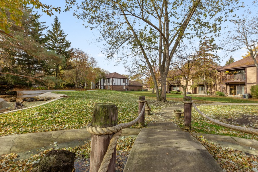 Real Estate Photography - 1731 Harrow Ct, D, Wheaton, IL, 60189 - Nearby Trail with bridge, stream, waterfall