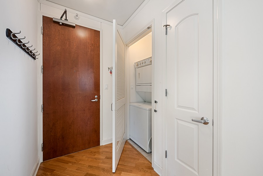 Real Estate Photography - 420 East Waterside Dr, 1403, Chicago, IL, 60601 - Laundry Room
