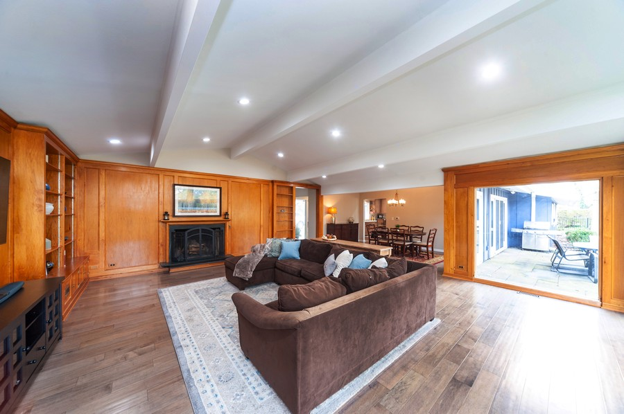 Real Estate Photography - 1555 Tower Rd, Winnetka, IL, 60093 - Living Room / Dining Room / Patio View