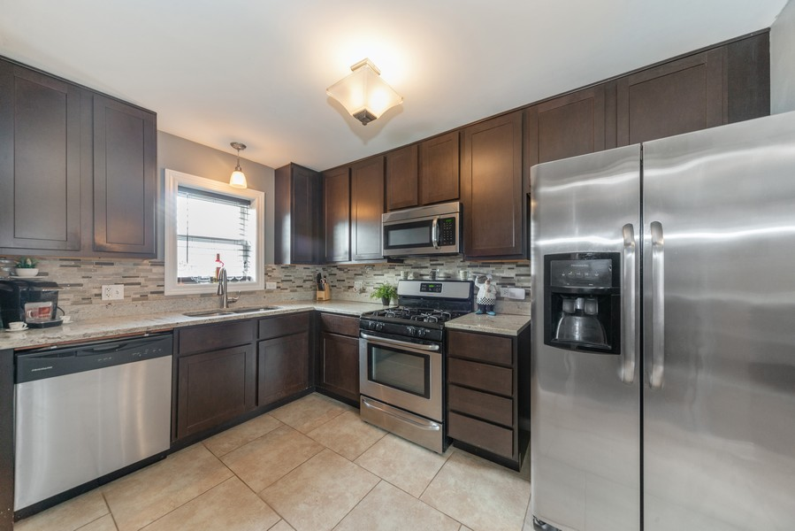 Real Estate Photography - 3124 Dora St, Franklin Park, IL, 60131 - Kitchen