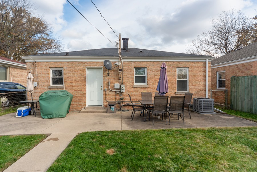 Real Estate Photography - 3124 Dora St, Franklin Park, IL, 60131 - Rear View