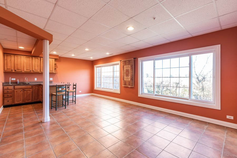Real Estate Photography - 33051 North Stone Manor Dr, Grayslake, IL, 60030 - Entertainment Room Walkout to Patio