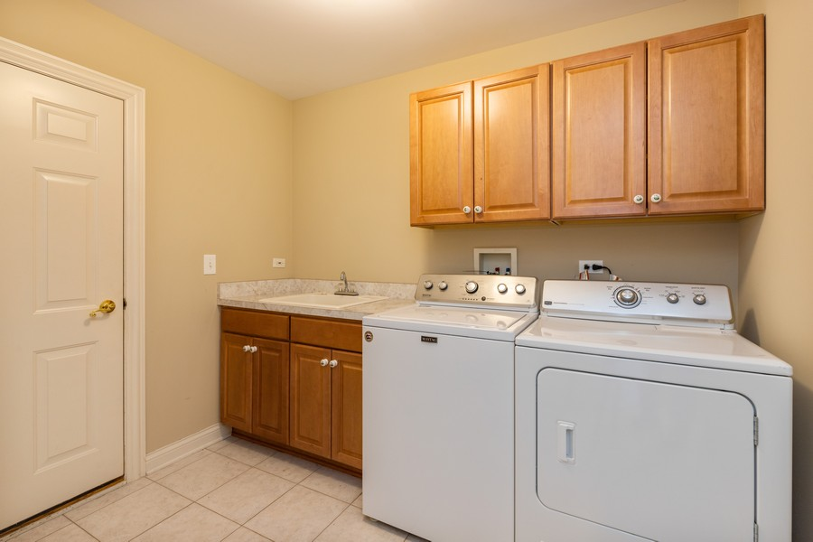 Real Estate Photography - 33051 North Stone Manor Dr, Grayslake, IL, 60030 - Laundry Room