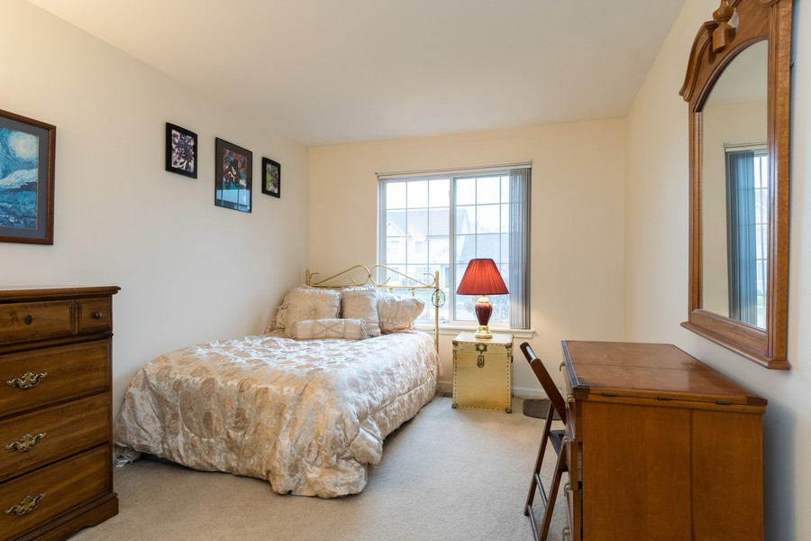 Real Estate Photography - 655 Lincoln Station Dr, 1002, Oswego, IL, 60543 - 2nd Bedroom