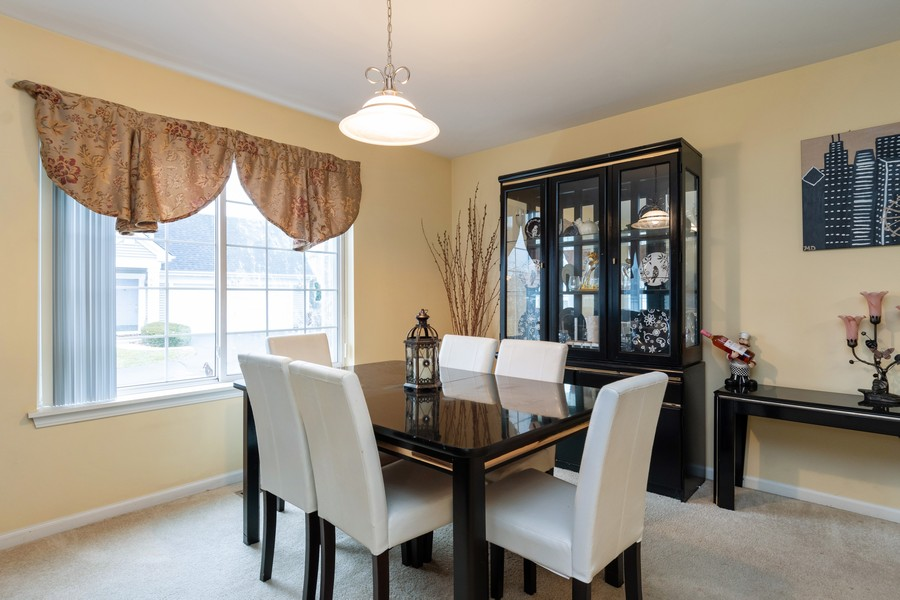 Real Estate Photography - 655 Lincoln Station Dr, 1002, Oswego, IL, 60543 - Dining Room