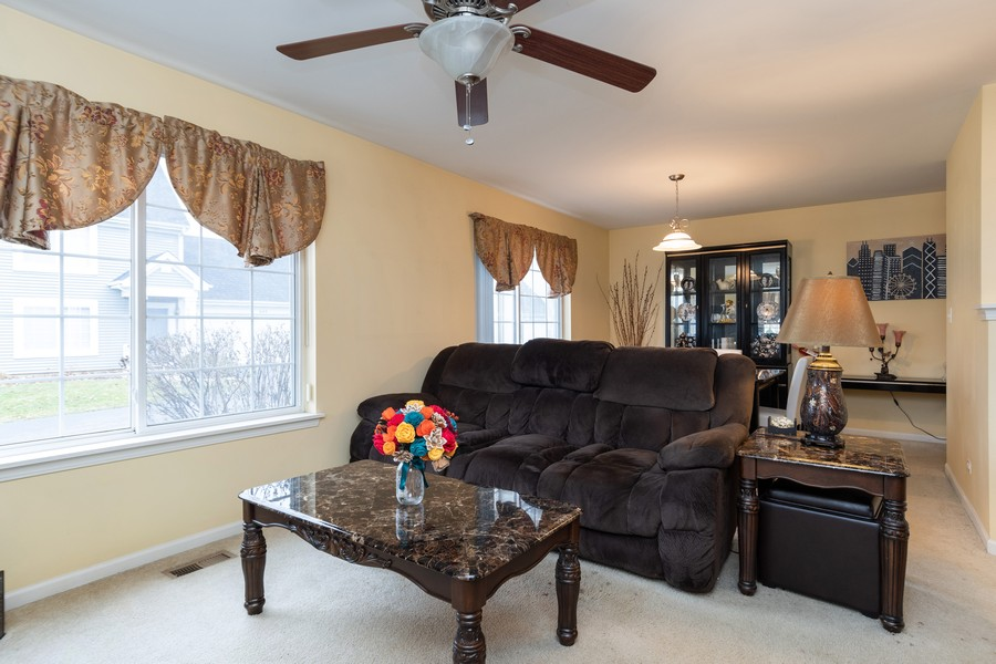 Real Estate Photography - 655 Lincoln Station Dr, 1002, Oswego, IL, 60543 - Family Room