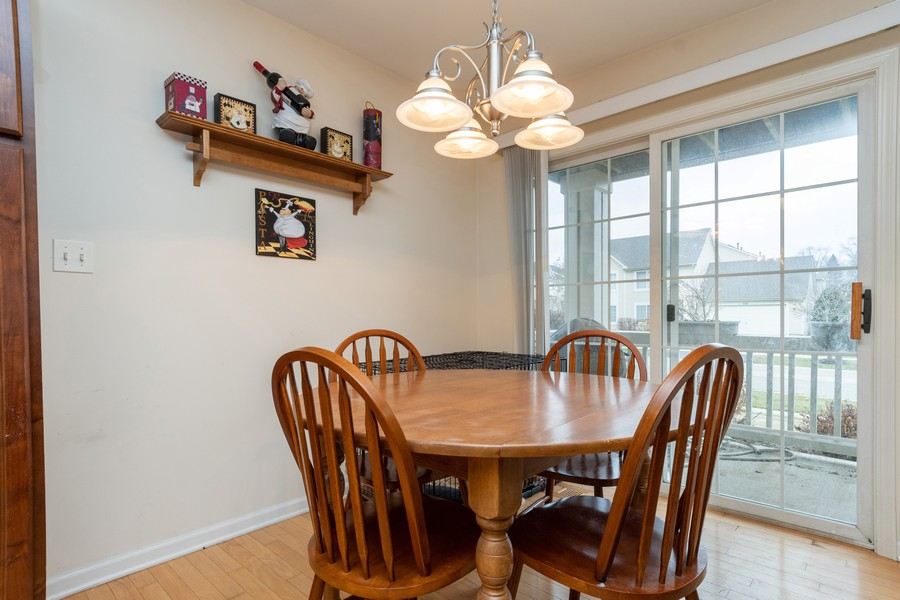Real Estate Photography - 655 Lincoln Station Dr, 1002, Oswego, IL, 60543 - Breakfast Area