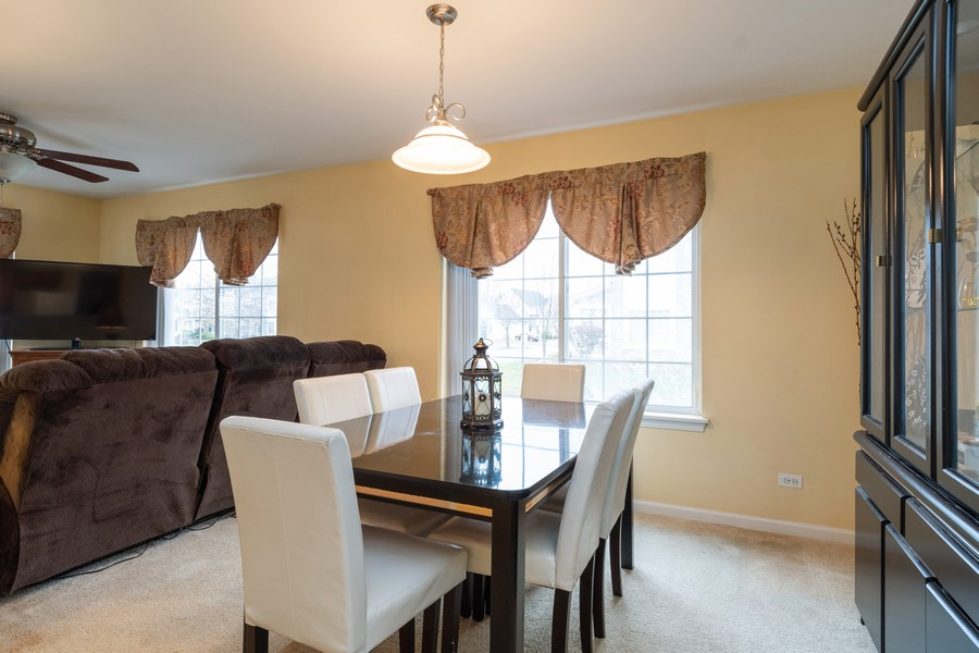 Real Estate Photography - 655 Lincoln Station Dr, 1002, Oswego, IL, 60543 - Dining Area
