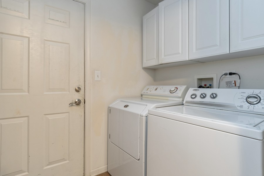 Real Estate Photography - 655 Lincoln Station Dr, 1002, Oswego, IL, 60543 - Laundry Room