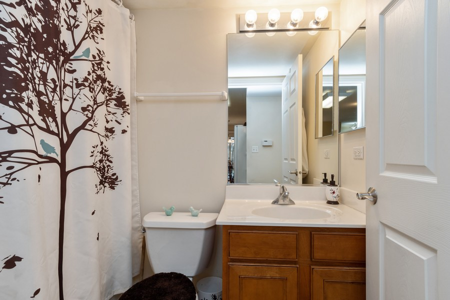Real Estate Photography - 655 Lincoln Station Dr, 1002, Oswego, IL, 60543 - 2nd Bathroom