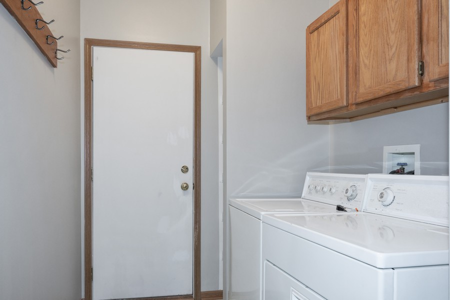Real Estate Photography - 341 Cascade Ln, Oswego, IL, 60543 - Main Floor Laundry Room with Door to 2 Car Garage