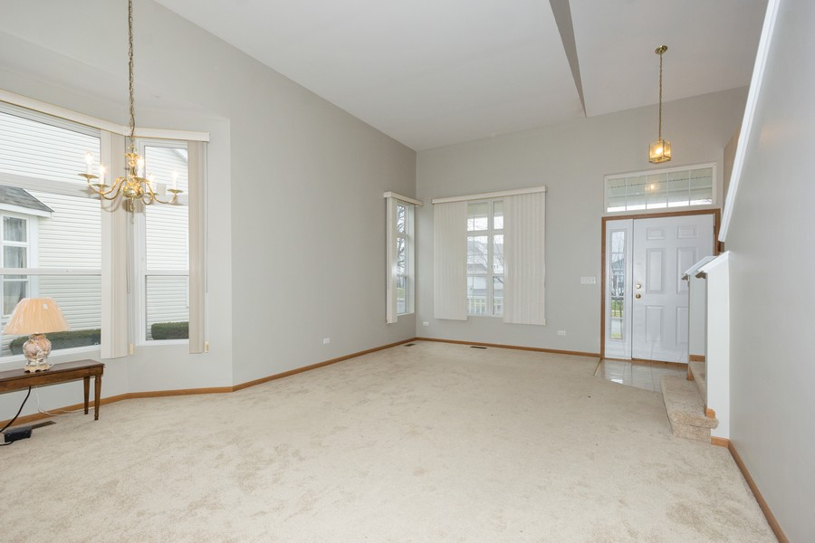 Real Estate Photography - 341 Cascade Ln, Oswego, IL, 60543 - Living Room / Dining Room