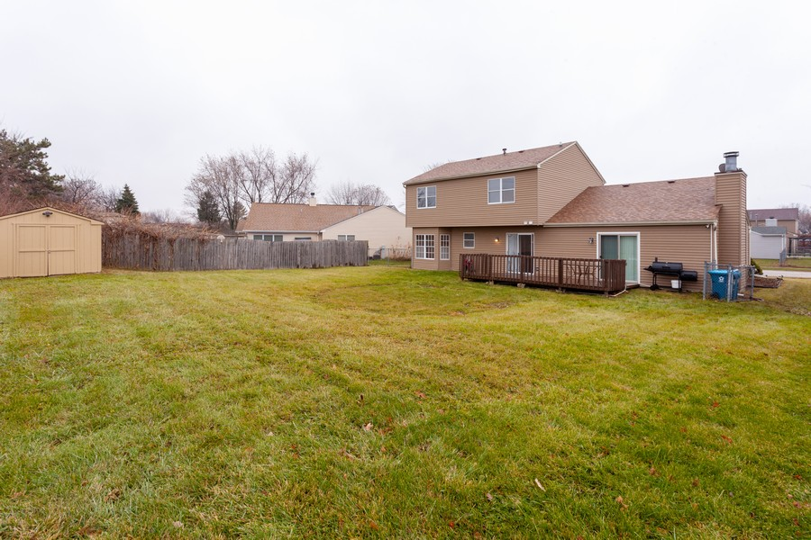 Real Estate Photography - 909 Fieldside Ln, Aurora, IL, 60504 - Rear View