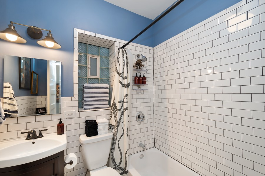 Real Estate Photography - 2630 North Troy St, Chicago, IL, 60647 - 1st Floor Bathroom