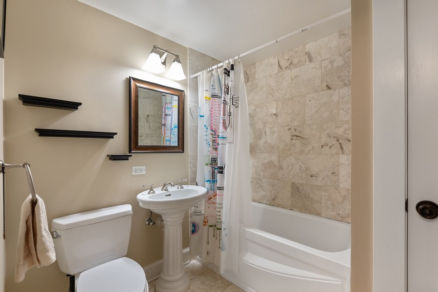 Real Estate Photography - 1112 Church St, 1, Evanston, IL, 60201 - 2nd Bathroom