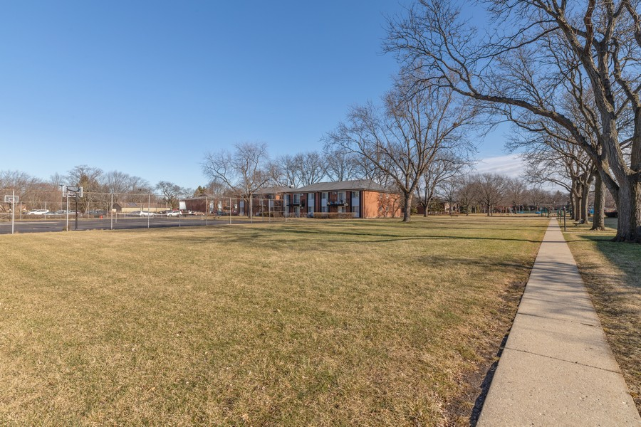 Real Estate Photography - 1215 North Waterman Ave, 2E, Arlington Heights, IL, 60004 - Courtyard with Tennis Courts & Swimming Pool