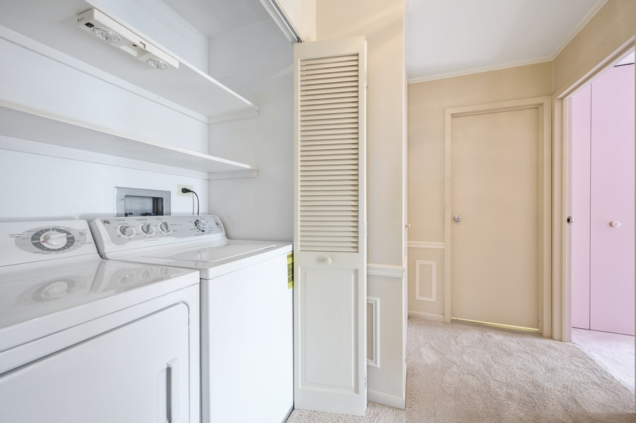 Real Estate Photography - 1555 W Astor, 24W, Chicago, IL, 60610 - Laundry Room