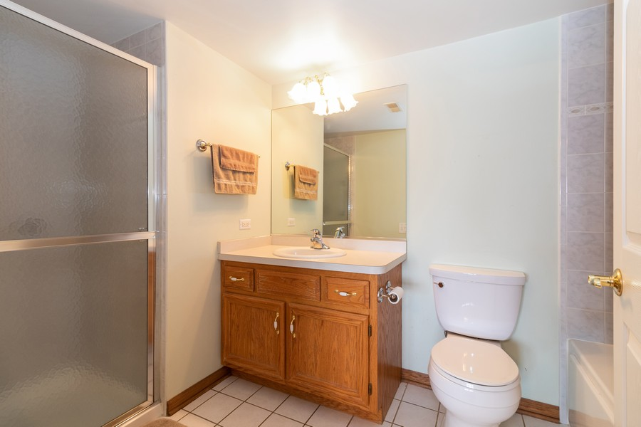 Real Estate Photography - 16040 Boardwalk Ln, 2A, Orland Park, IL, 60467 - Master Bathroom