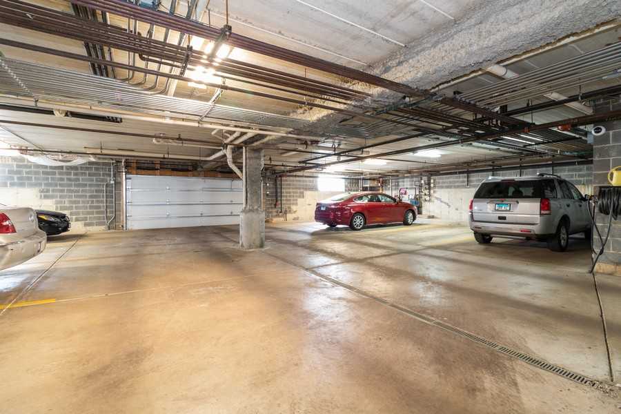Real Estate Photography - 16040 Boardwalk Ln, 2A, Orland Park, IL, 60467 - Garage