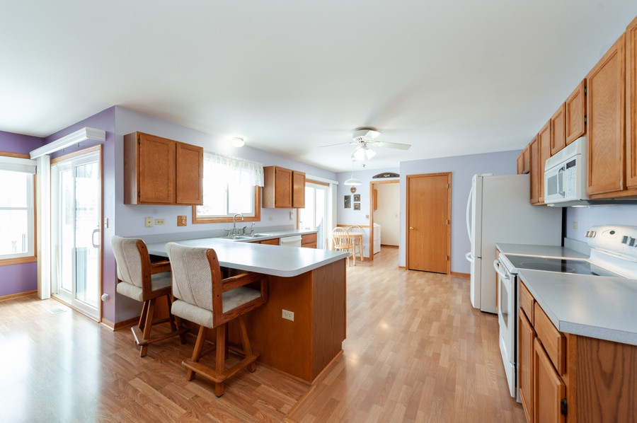 Real Estate Photography - 8807 Regnier Rd, Hebron, IL, 60034 - Kitchen