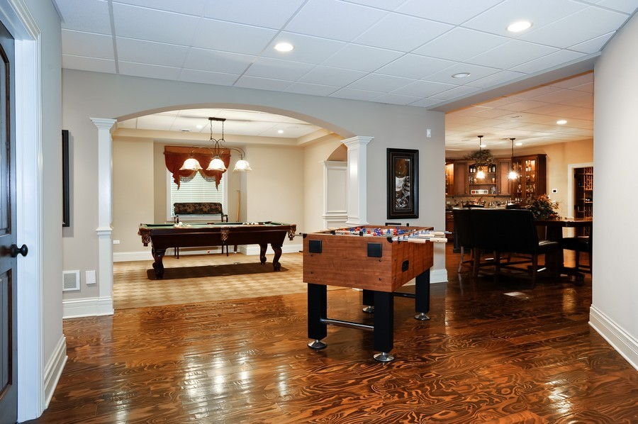 Real Estate Photography - 4508 Corktree, Naperville, IL, 60564 - Pool Table Area, Game Table in Lower Level