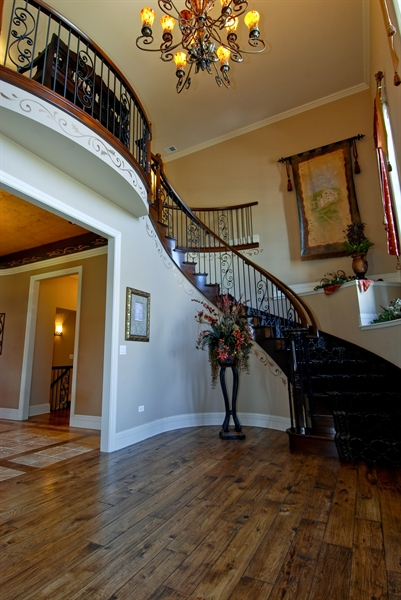 Real Estate Photography - 4508 Corktree, Naperville, IL, 60564 - Foyer with Custom Curved Staircase & Wrought Iron