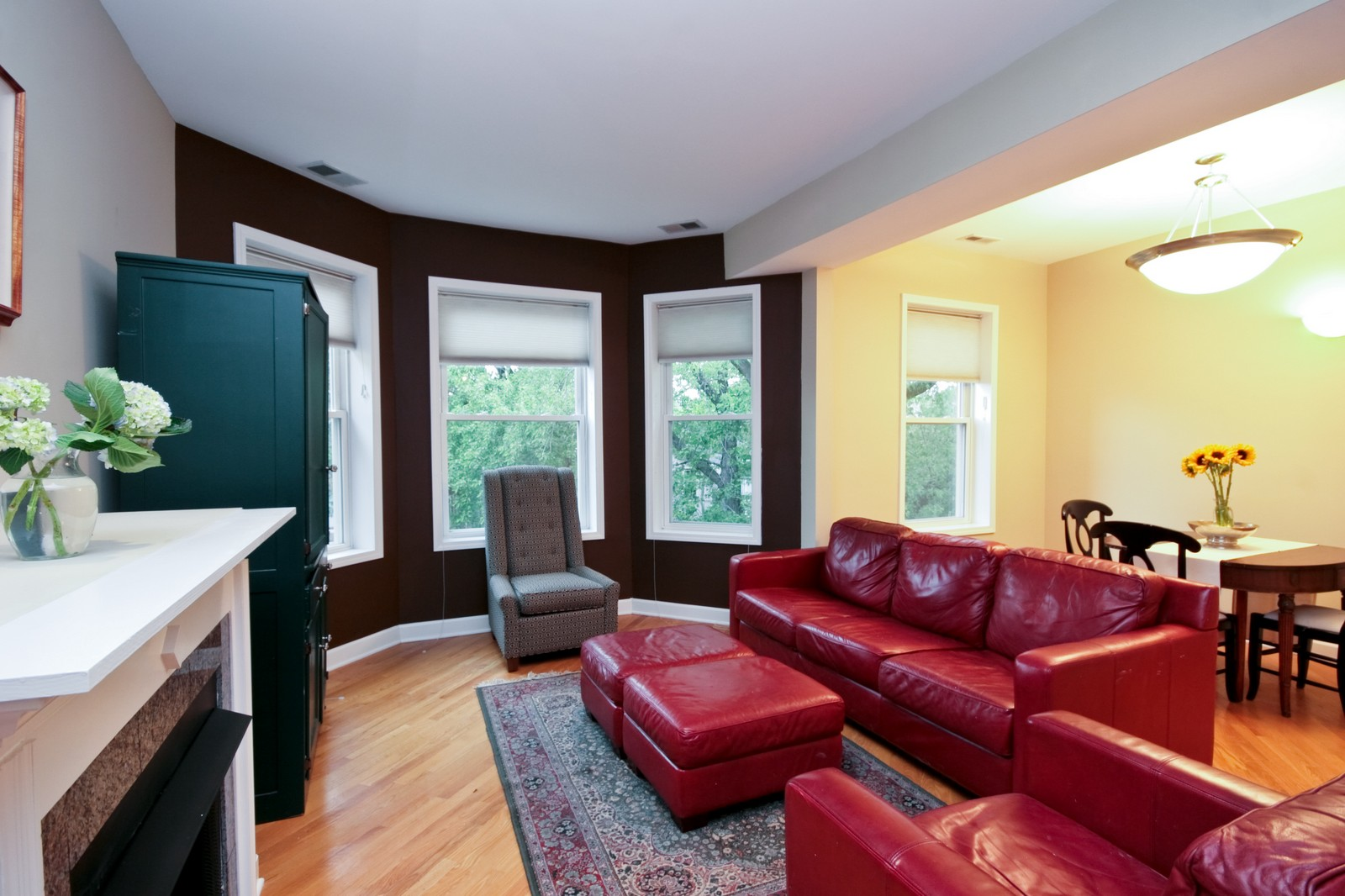 Real Estate Photography - 3705 N Paulina, Unit 3, Chicago, IL, 60613 - Living Room - Gas fireplace with granite surround