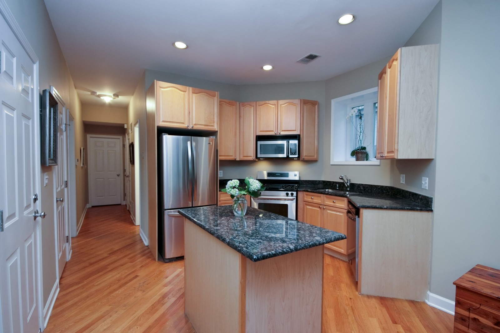 Real Estate Photography - 3705 N Paulina, Unit 3, Chicago, IL, 60613 - Kitchen - Granite island & countertops, stainless