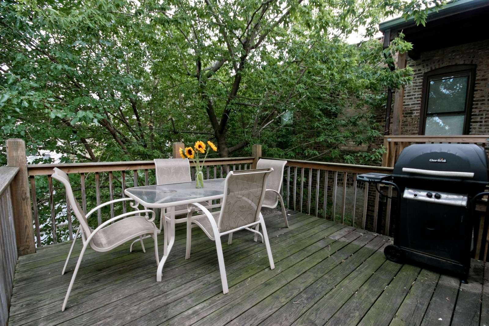 Real Estate Photography - 3705 N Paulina, Unit 3, Chicago, IL, 60613 - Deck - Tree surrounded private outdoor entertainin