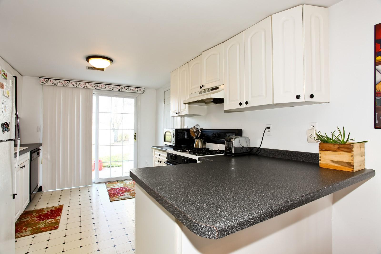 Real Estate Photography - 929 Seaman, Dekalb, IL, 60115 - Kitchen