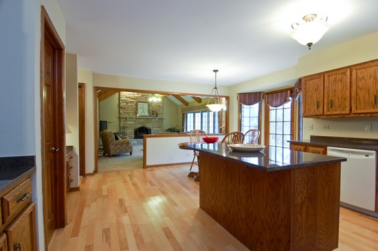 Family Room / Kitchen photograph of 1110 Champion Forest Wheaton Illinois 60187