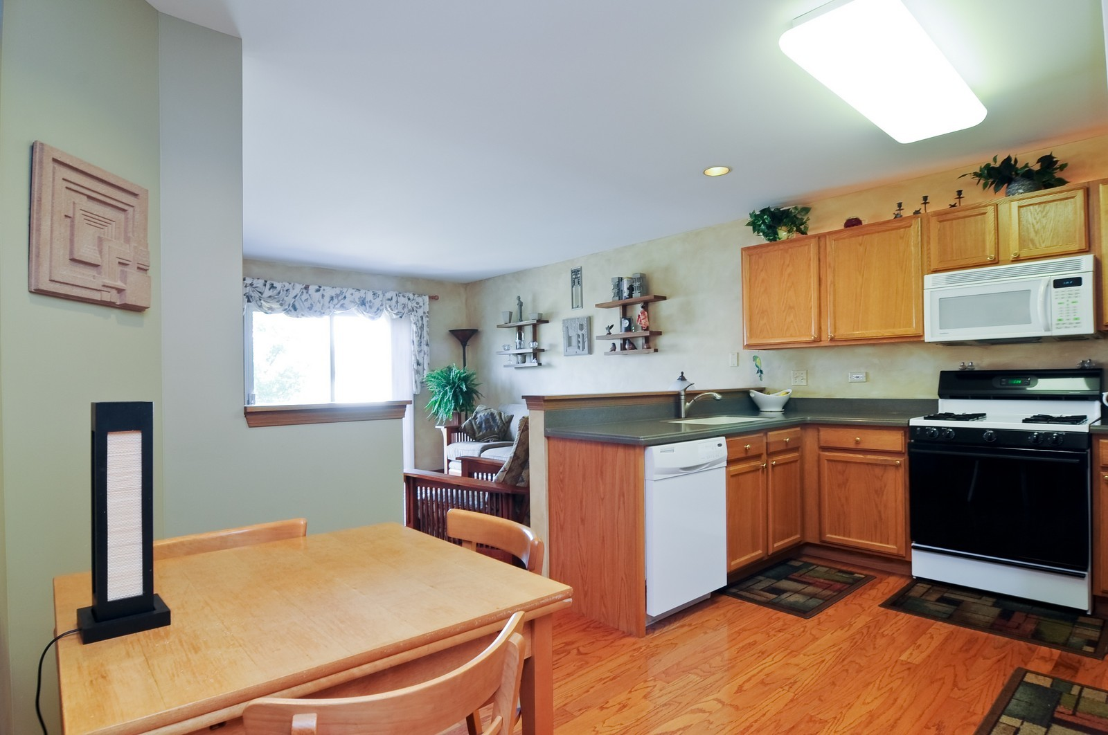 Real Estate Photography - 727 Sycamore, Lindenhurst, IL, 60046 - Kitchen / Breakfast Room