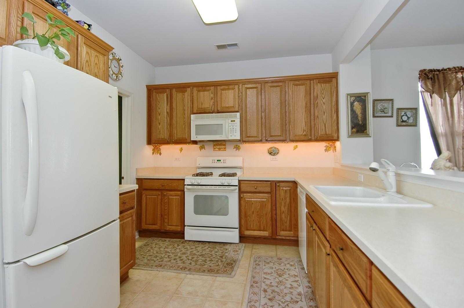 Real Estate Photography - 12206 Latham Trl, Huntley, IL, 60142 - Kitchen