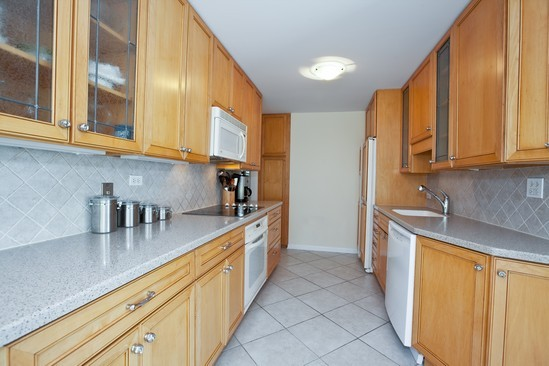 Kitchen . photograph of 1 Oak Brook Club Unit B205 Oak Brook Illinois 60523