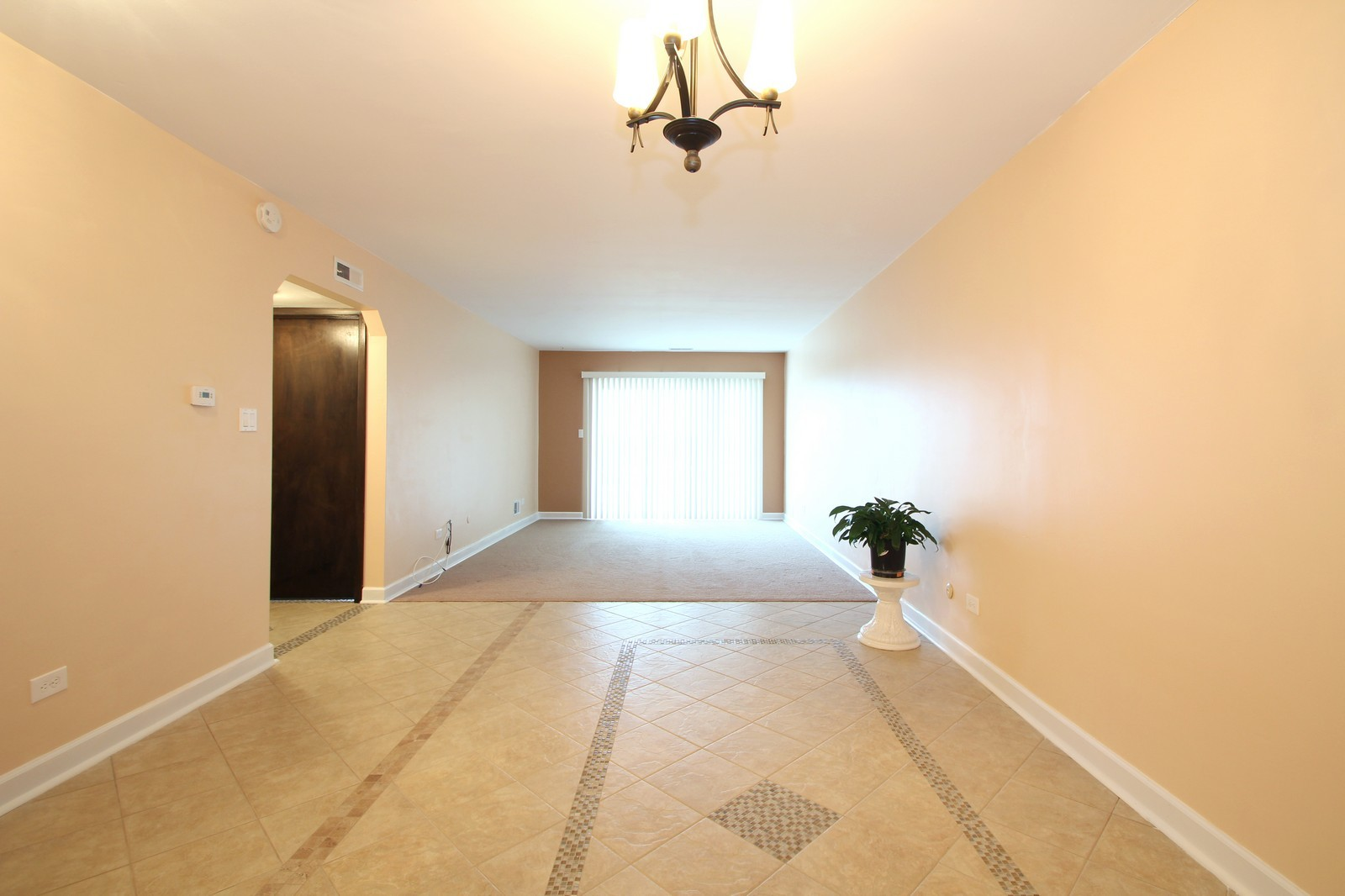 Real Estate Photography - 7525 W Lawrence, Unit 503, Harwood Heights, IL, 60706 - Living Room / Dining Room