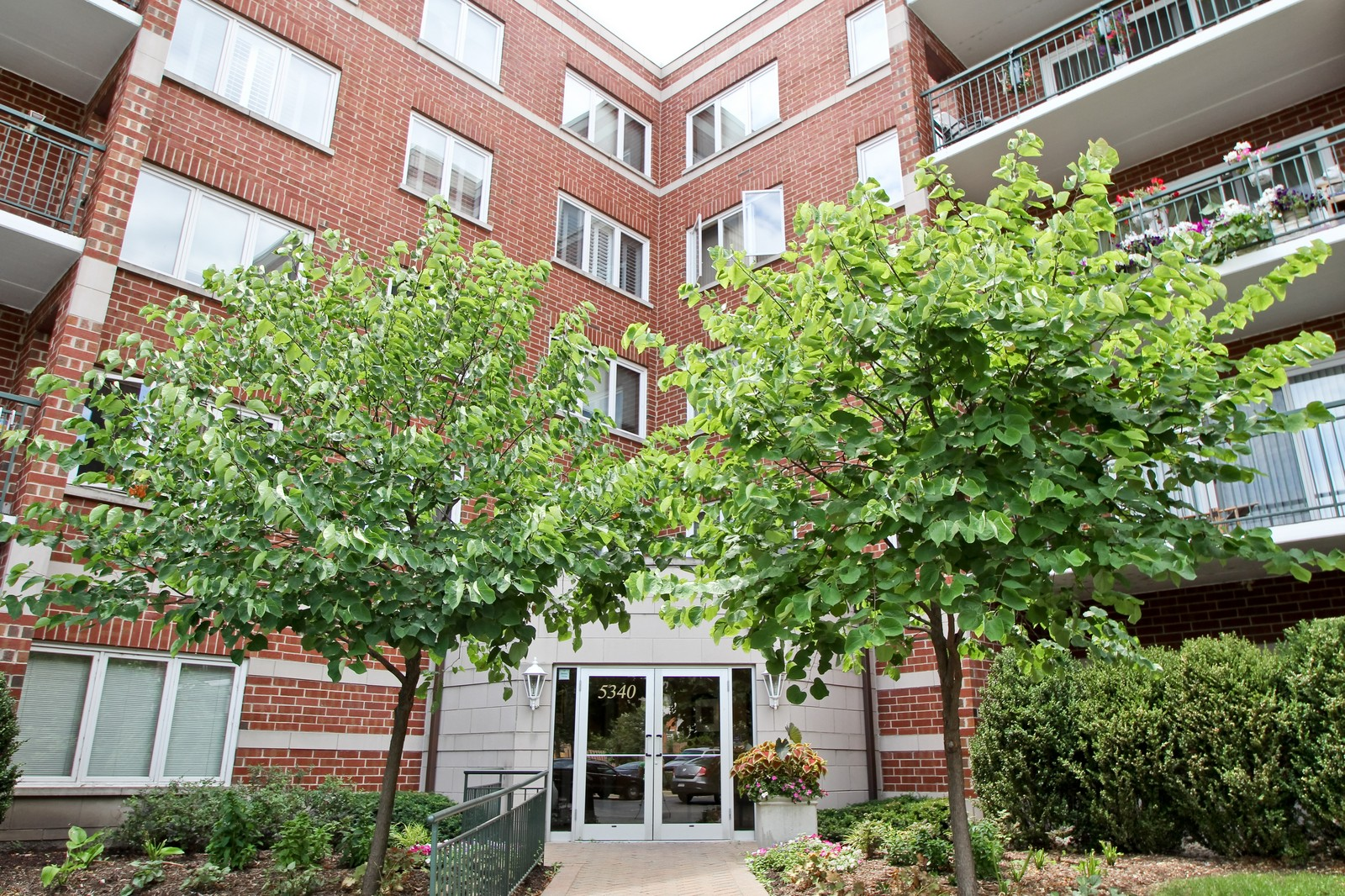 Real Estate Photography - 5340 N Lowell Ave, Unit 206, Chicago, IL, 60630 - Front View
