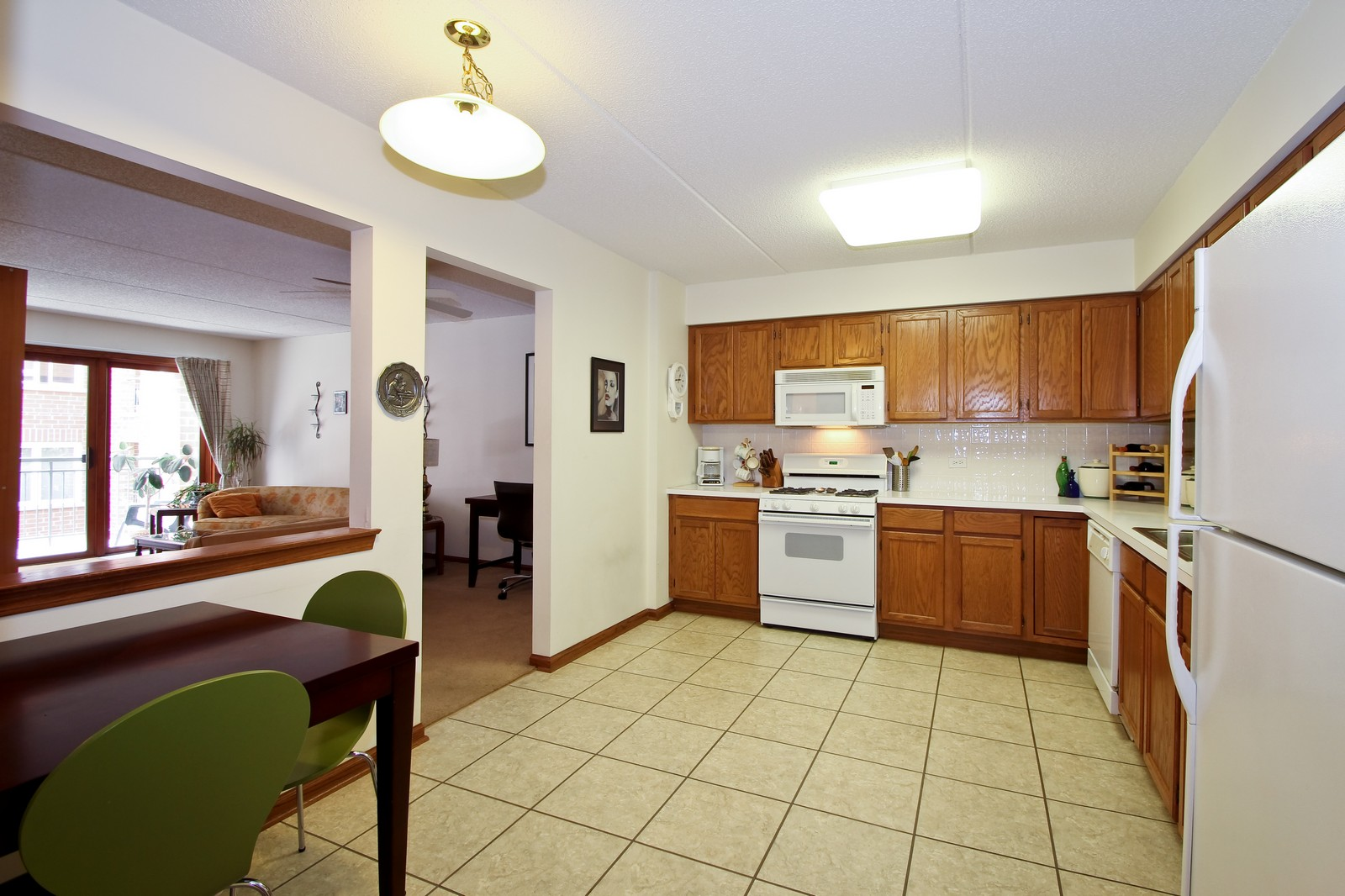 Real Estate Photography - 5340 N Lowell Ave, Unit 206, Chicago, IL, 60630 - Kitchen / Living Room