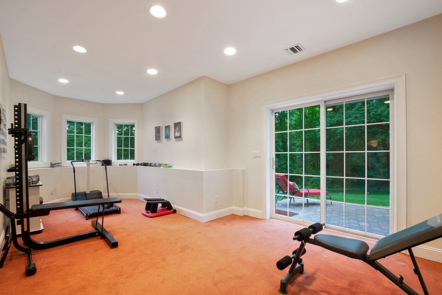 Real Estate Photography - 1048 Gambelli Dr, Yorktown Heights, NY, 10598 - Lower Level Exercise Room with SGD to patio
