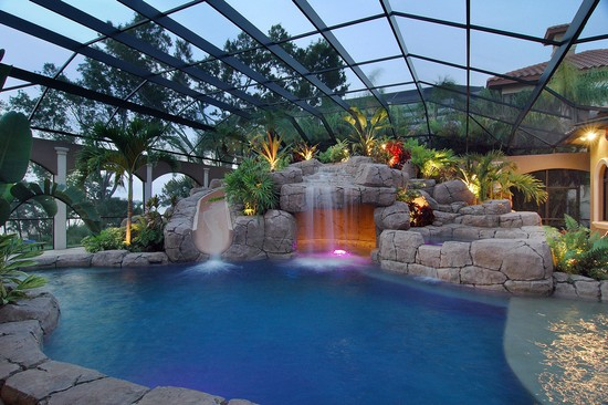 Real Estate Photography - 3755 Mullenhurst Dr, Palm Harbor, FL, 34685 - Pool at sunset w/swim up Grotto