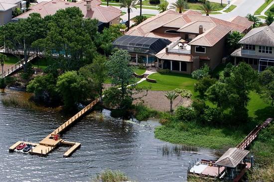 Real Estate Photography - 3755 Mullenhurst Dr, Palm Harbor, FL, 34685 - Boat Dock & jet ski dock steps from your lanai