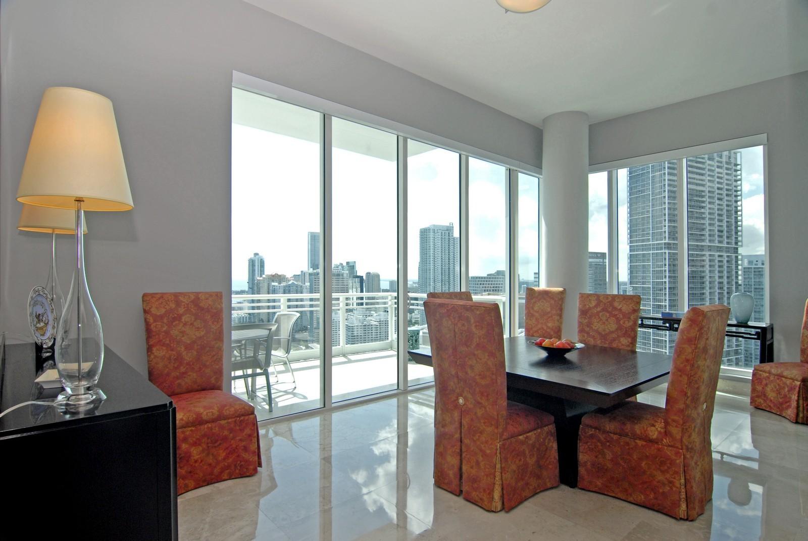 Real Estate Photography - 900 Brickell Key Blvd, Apt 3004, Miami, FL, 33131 - Dining Room