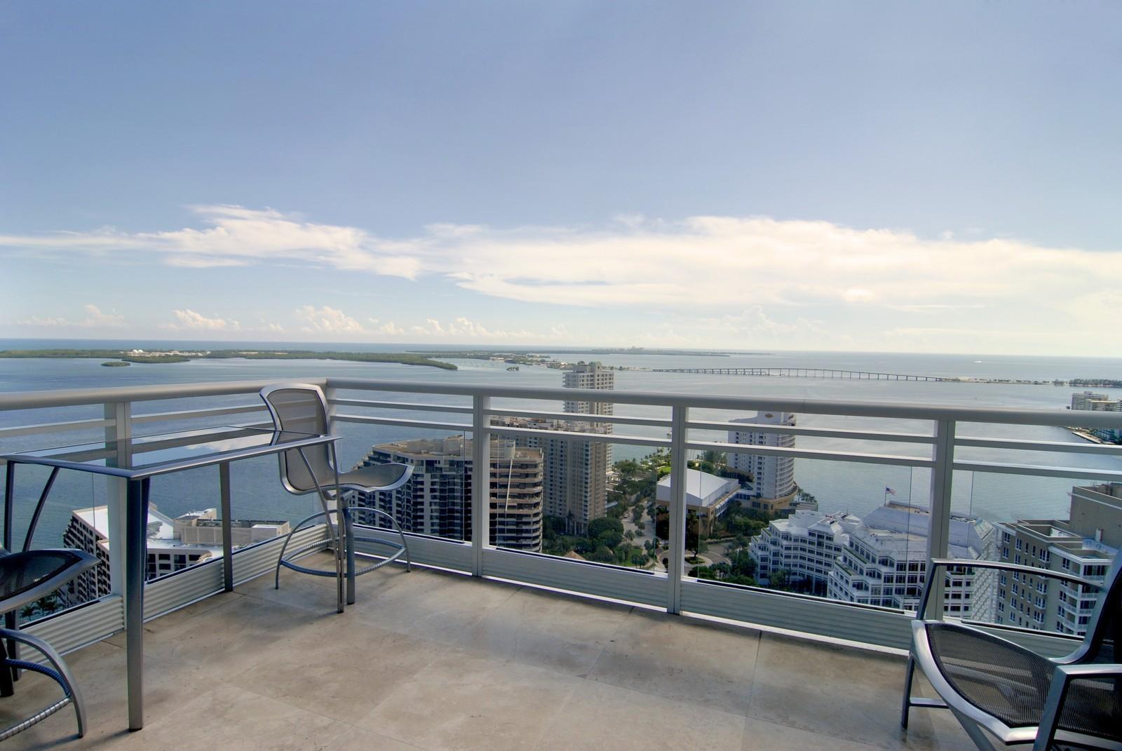 Real Estate Photography - 900 Brickell Key Blvd, Apt 3004, Miami, FL, 33131 - Living Rm balcony