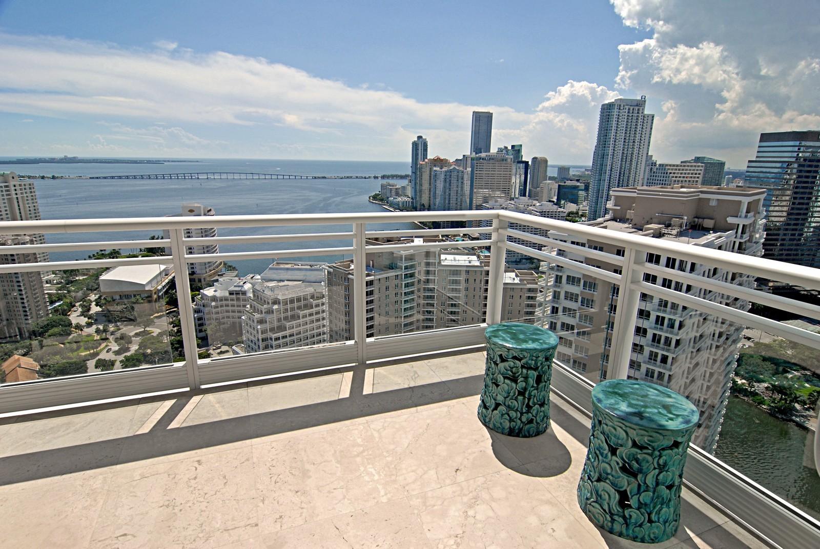 Real Estate Photography - 900 Brickell Key Blvd, Apt 3004, Miami, FL, 33131 - Dining Rm Balcony