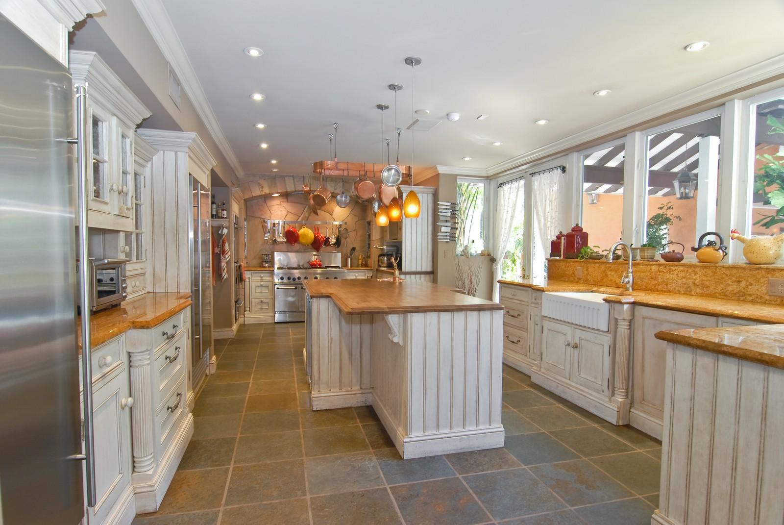 Real Estate Photography - 4845 Davis Rd, Miami, FL, 33143 - Kitchen